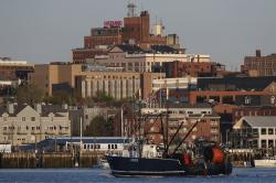In this May 21, 2020, file photo a fishing trawler arrives in Portland, Maine