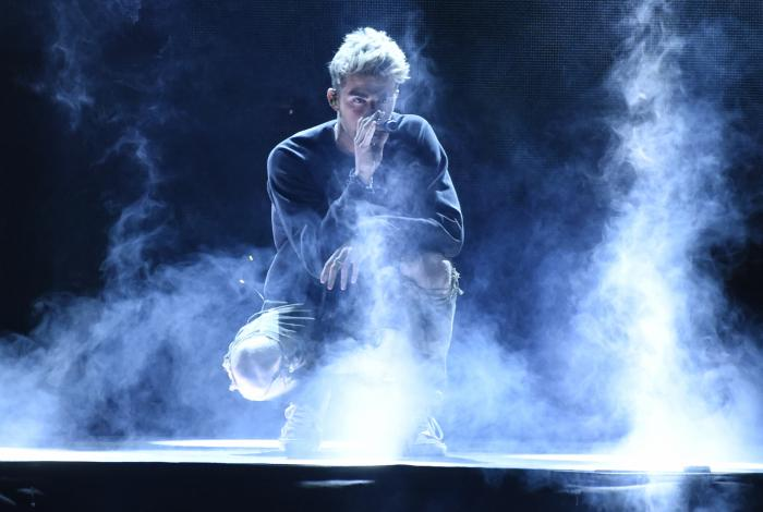 """Andrew Taggart, of The Chainsmokers, performs """"Sick Boy"""" at WE Day California at The Forum in Inglewood, Calif."""
