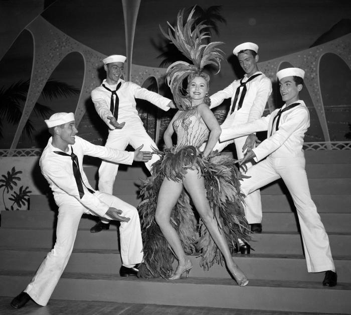 Actress Rhonda Fleming blossoms out as a singer and dancer in the first night club appearance of her career at the New Tropicana hotel in Las Vegas in 1957.