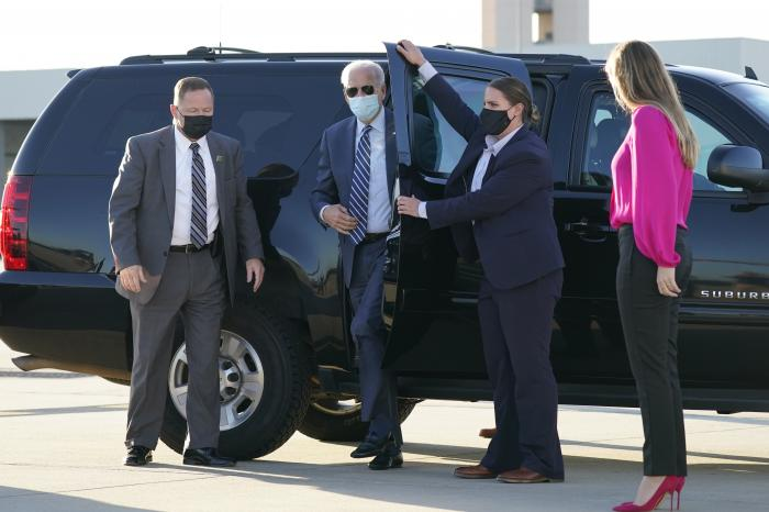 Democratic presidential candidate former Vice President Joe Biden steps out to board his campaign plane at Raleigh-Durham International Airport in Morrisville, N.C.
