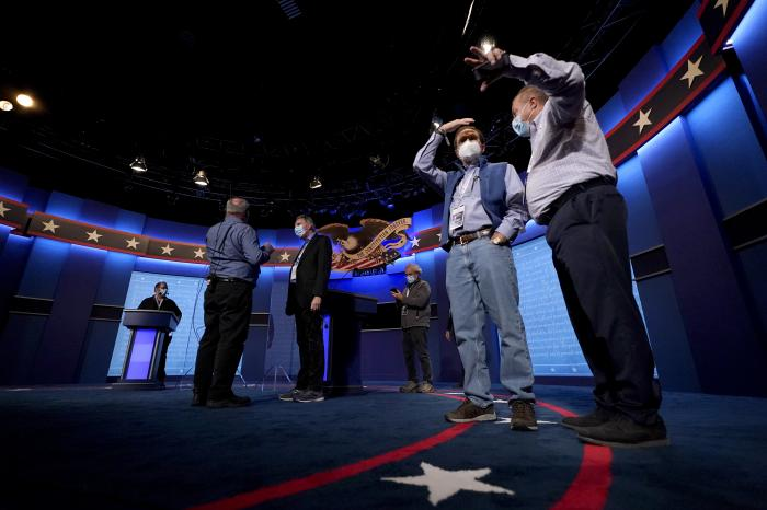 Production crew member stand on stage ahead of the final presidential debate between Republican candidate President Donald Trump and Democratic candidate former Vice President Joe Biden.