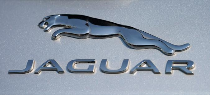 In this file photo dated Sunday, Sept. 6, 2020, the Jaguar car company logo shines off the deck of an I-Pace electric vehicle at a Jaguar dealership, in Littleton, USA