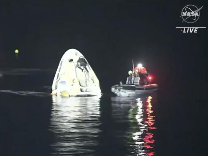 In this image made from NASA TV video, the SpaceX Dragon capsule floats after landing in the Gulf of Mexico near the Florida Panhandle early Sunday, May 2, 2021