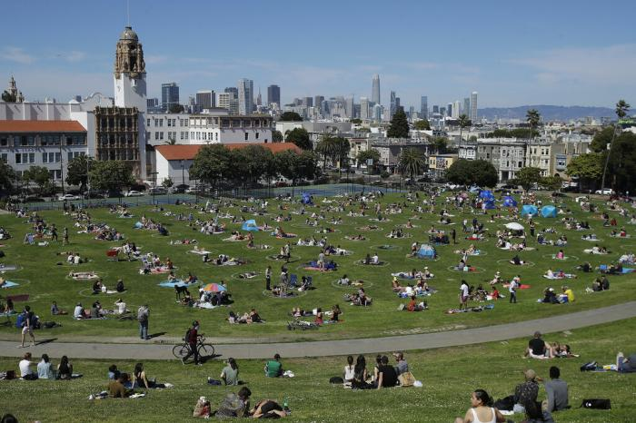 Visitors set up inside circles designed to help prevent the spread of the coronavirus by encouraging social distancing at Dolores Park in San Francisco.
