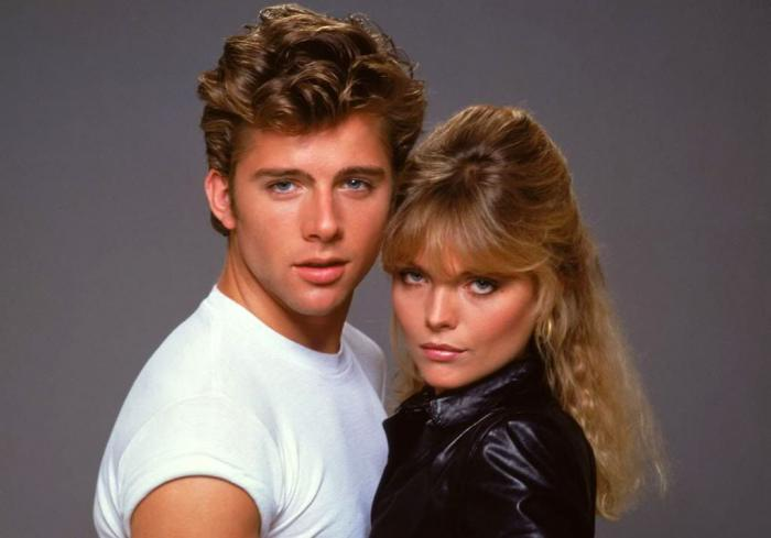 """Maxwell Caulfield and Michelle Pfeiffer in a promotional picture for 1982's """"Grease 2"""""""