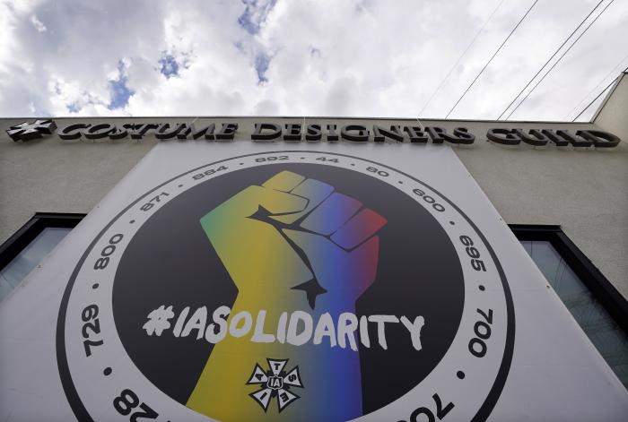 A poster advocating union solidarity hangs from a Costume Designers Guild office building, Monday, Oct. 4, 2021, in Burbank, Calif.
